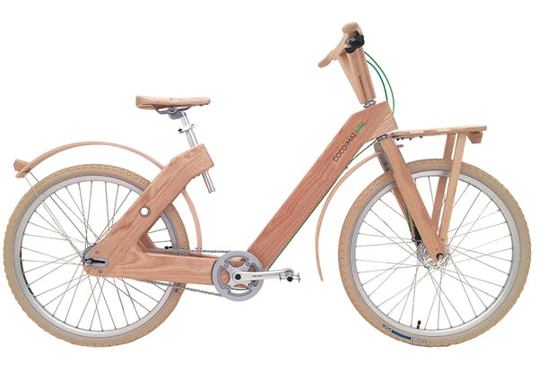 a bicycle sitting on a wooden pole