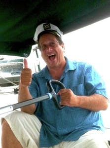 a man holding a baseball bat