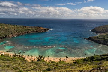 an island in the middle of a body of water with Hanauma Bay in the background