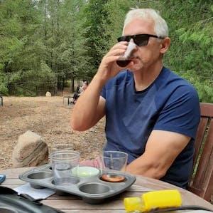 a man sitting at a picnic table