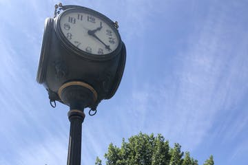 a clock tower on top of a pole
