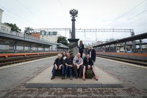 a group of people on a train track