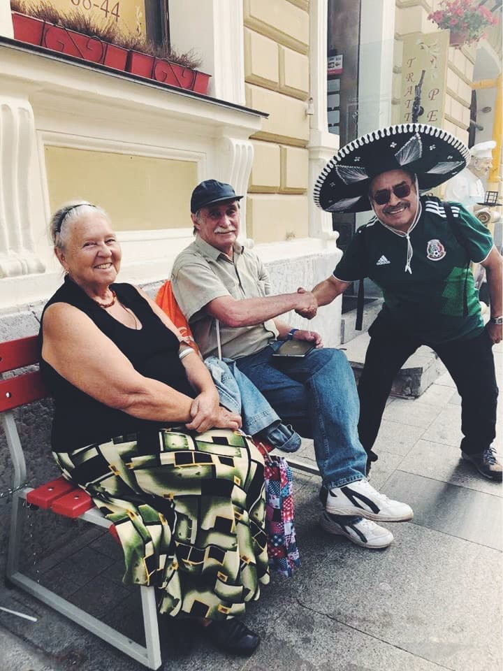Mexican tourist in Russia cheering Russian elderly people Moscow FIFA 2018