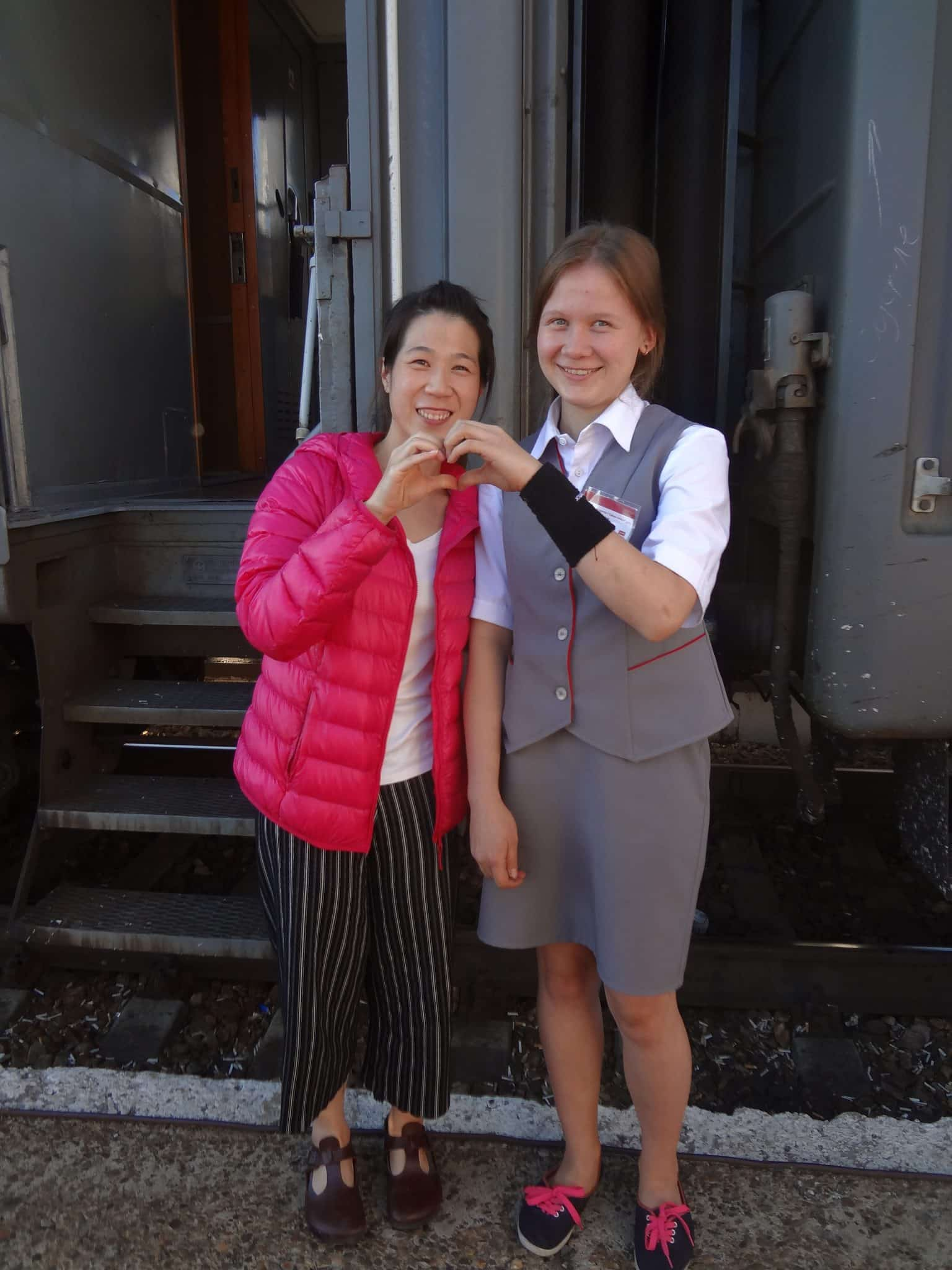 Trans-Siberian Railroad Provodnitsa with traveller