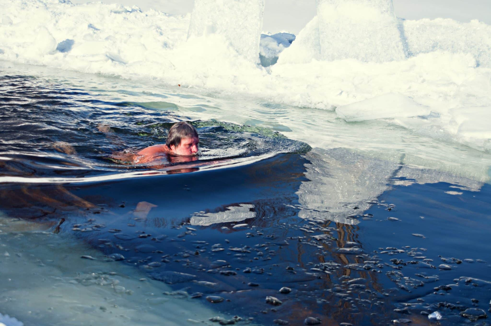 winter ice-hole swimming during trans-siberian railway tour
