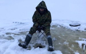 Ice-hole fishing in winter