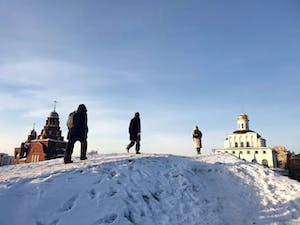 a group of people standing on top of a snow covered slope