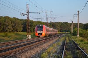 a large long train on a railroad track