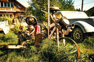 a group of parked motorcycles sitting on top of a grass covered field