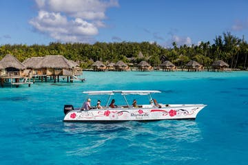An outrigger canoe sailing in Bora Bora