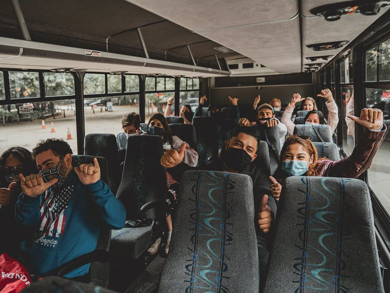 tour group on bus wearing masks