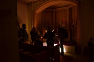 a group of people in a dark room
