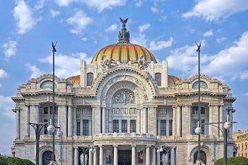 a statue in front of Palacio de Bellas Artes