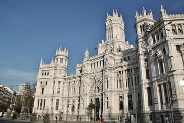 a large statue in front of Plaza de Cibeles