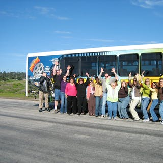 Group in front of the Monterey Movie Tours bus