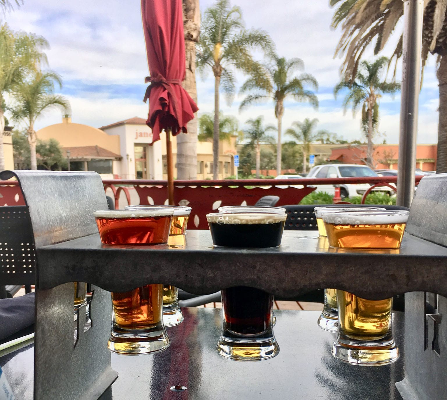 Beer sampler on outdoor patio at Hollister Brewing Co