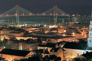 a large bridge lit up at night