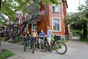 group of friends posing with bikes in neighboorhood
