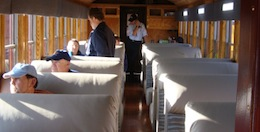 Travelers look out the window on one of the Durango, CO trains.