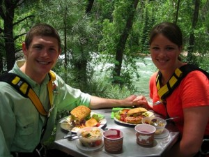 A couple enjoys lunch between zipline spans at Soaring Tree Top Adventures.