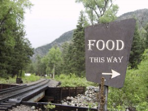 A sign marks where to find food in Durango, Colorado.