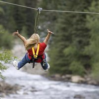 A zipliner crosses the Animas River at Soaring Tree Top Adventures.