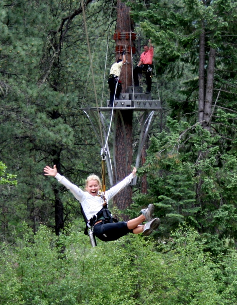 Kelly Ripa flies down a zipline span at Soaring Tree Top Adventures.