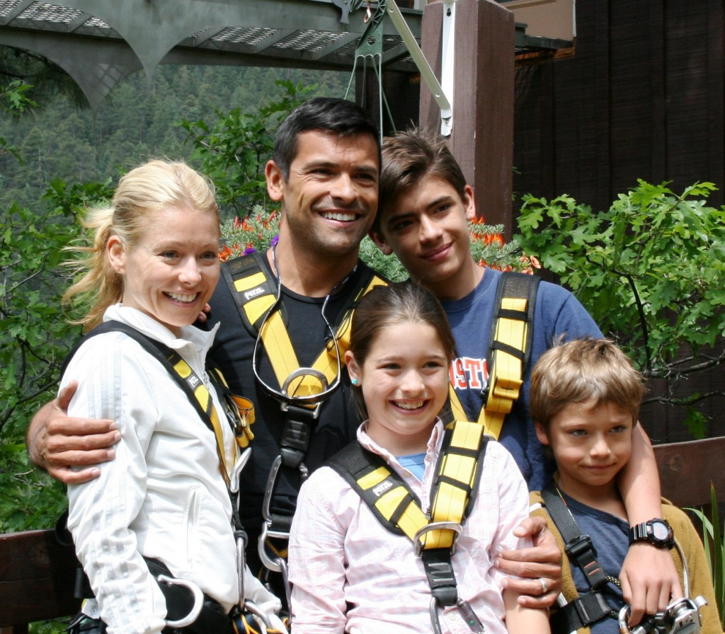 Kelly Ripa, Mark Consuelos and their children pose at Soaring Tree Top Adventures.