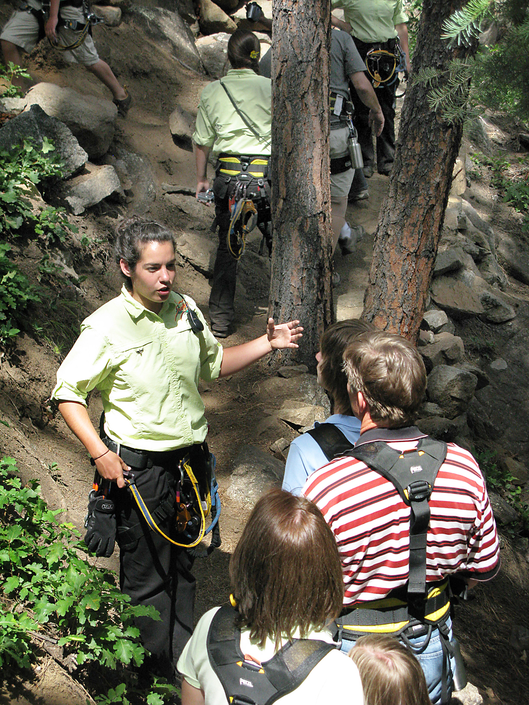 A Soaring Tree Top Adventure Sky Ranger explains safety procedures to zipliners.