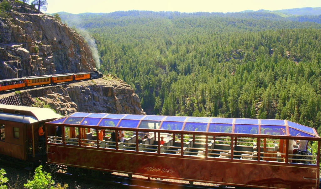 A train carries zipliners to Soaring Tree Top Adventures