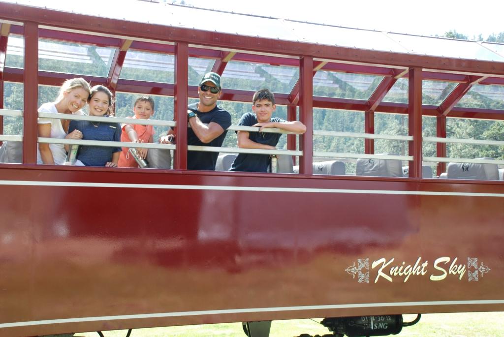 Kelly Ripa, Mark Consuelos and their children pose on the Durango train.