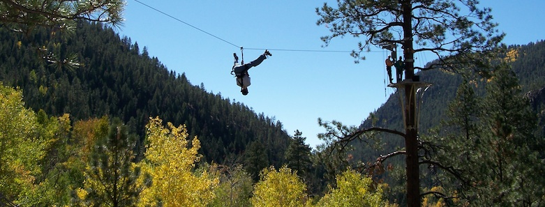 A zipline visitor flips upside down in his harness at Soaring Tree Top Adventures.