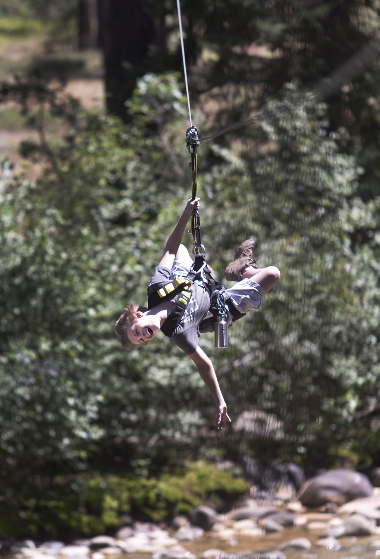 A guest having fun at Soaring Treetop Adventures.