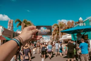 Person holding a Universal Studios ticket.