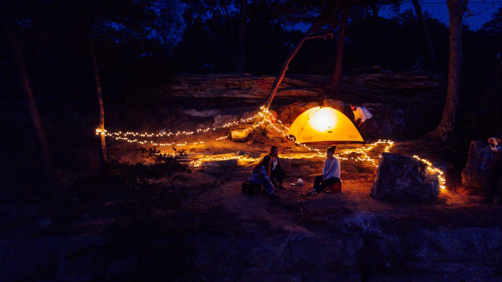 a campsite decorated with lights at night