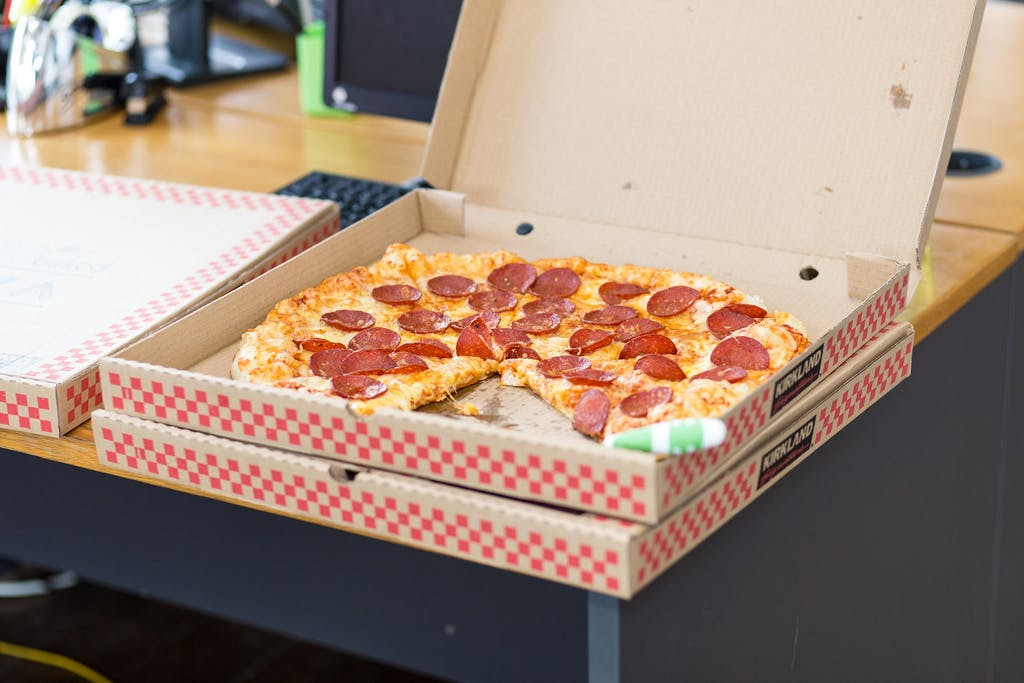 a box of pizza sitting on top of a table