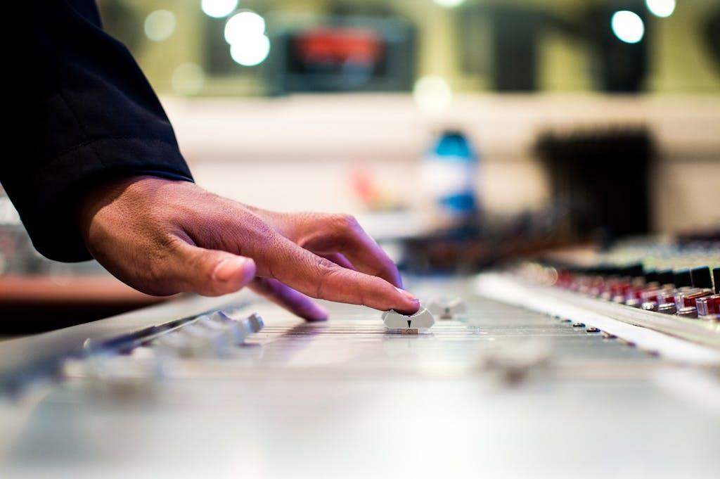A DJ sound mixing.
