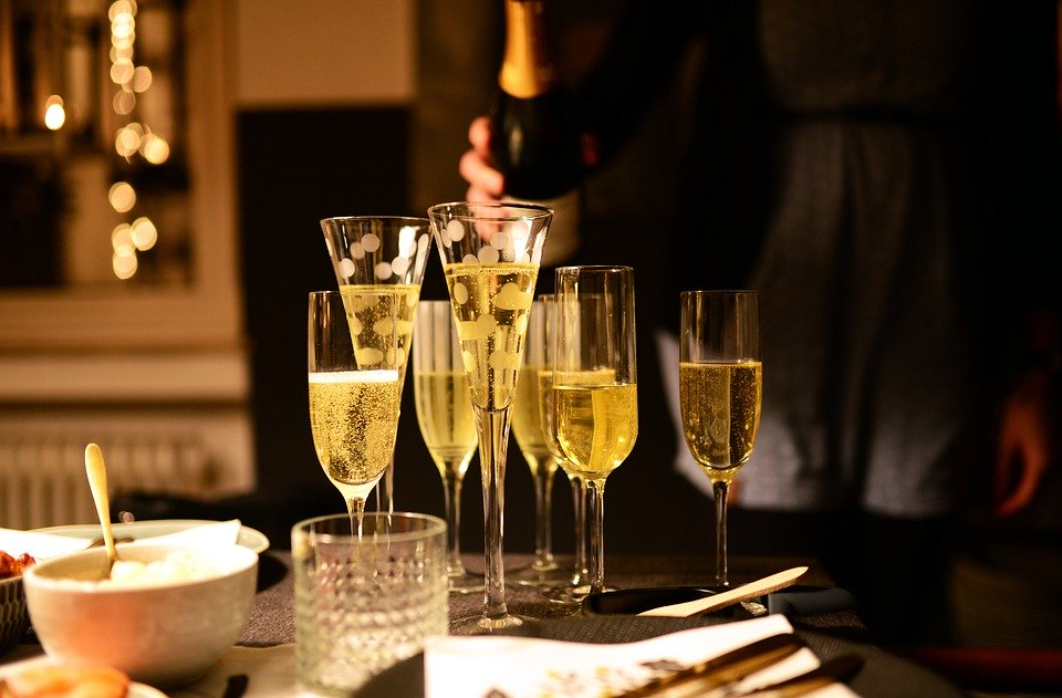 champagne glasses on a table during a party.