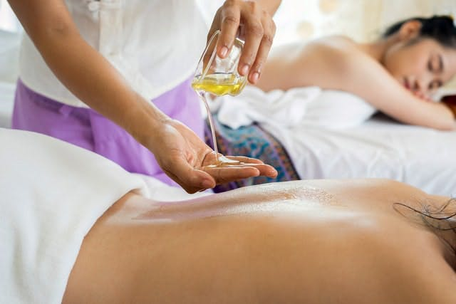 Two girls having massages, one of the unconventional bachelorette ideas