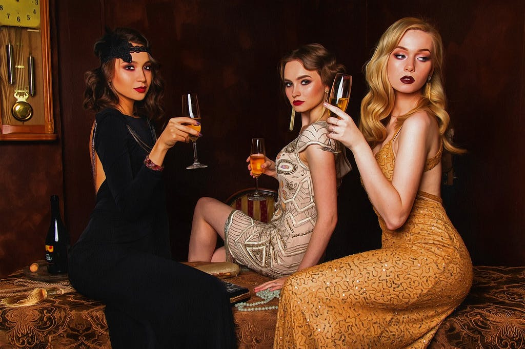 30's style photo shoot with three glamourous-looking ladies.
