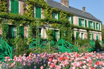 a colorful flower garden in front of a building