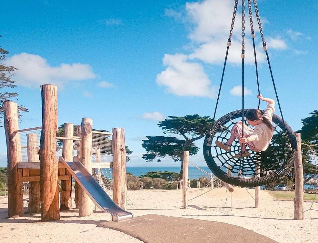 a swing at a beach