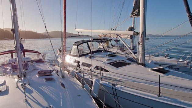 Sun reflects off sailboats in San Diego Bay