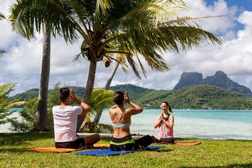A couple doing a yoga session in Bora Bora