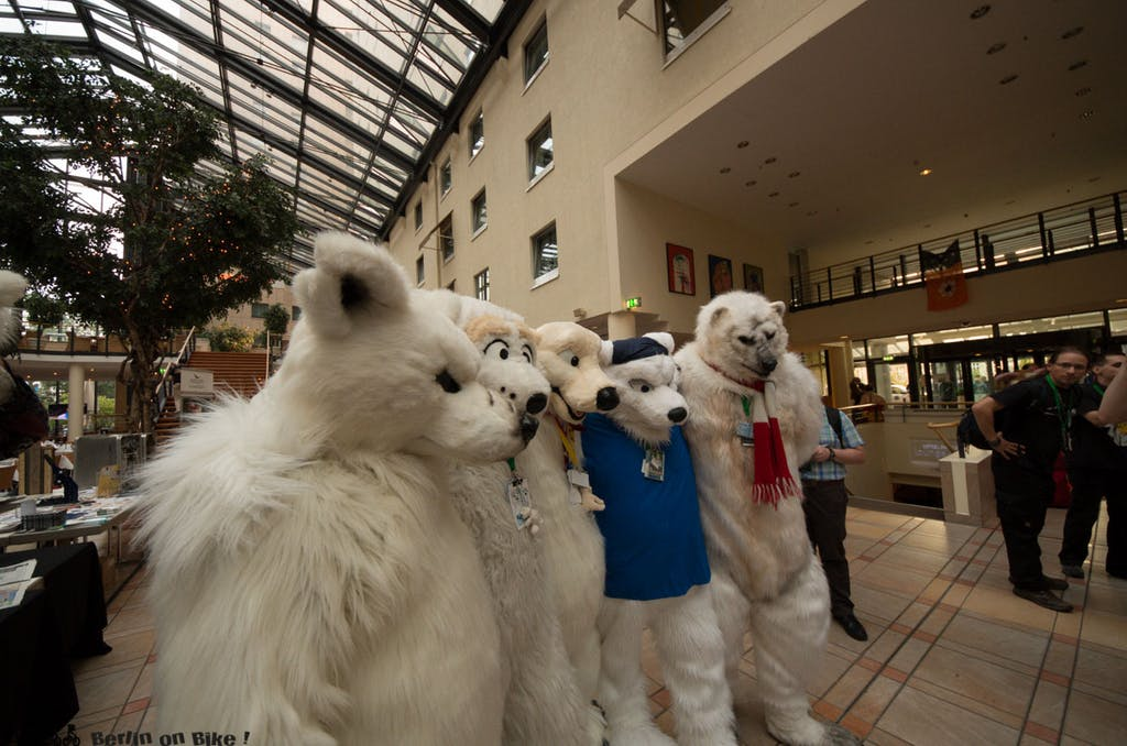 a group of stuffed animals on display in front of a building