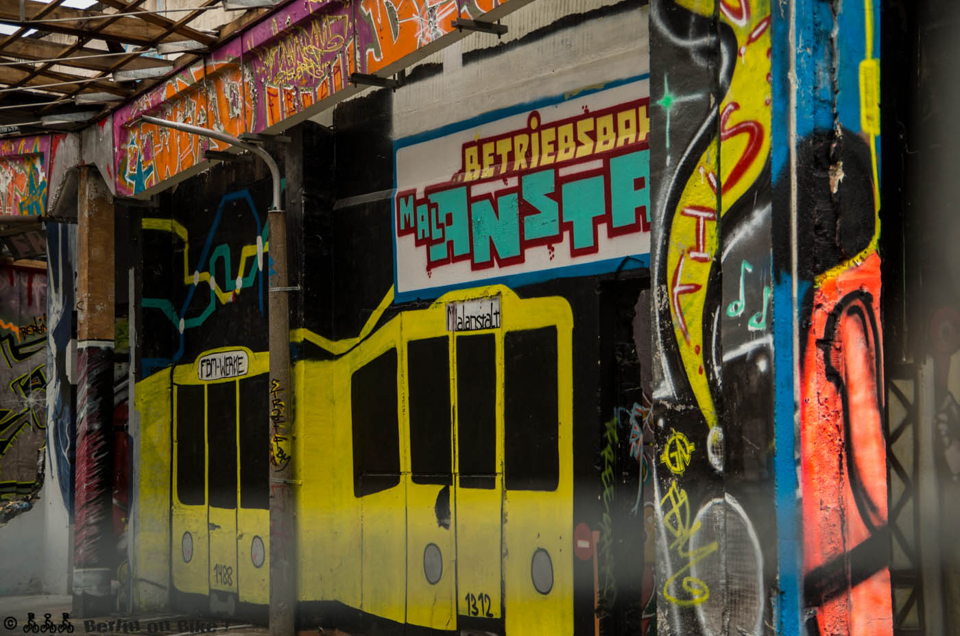 a train covered in graffiti