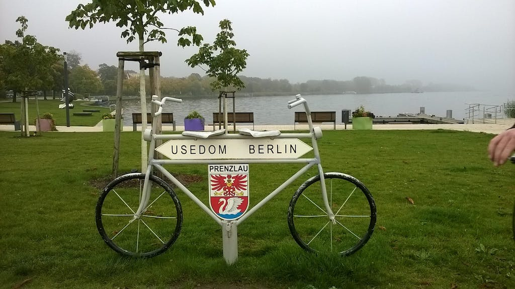 a bicycle parked on the grass