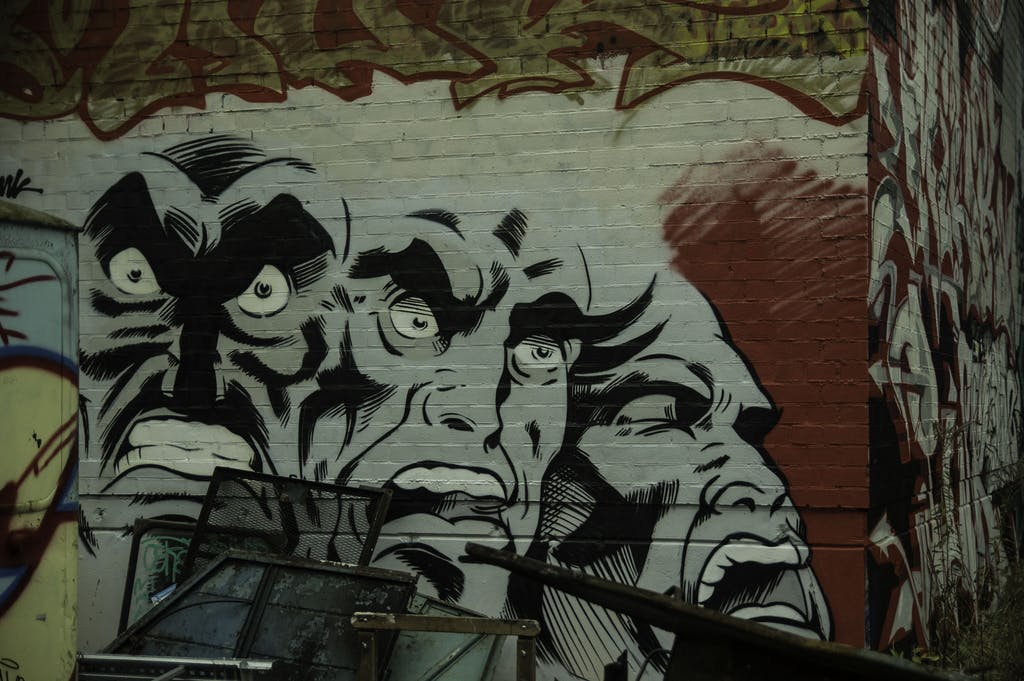 a painting of a graffiti covered wall