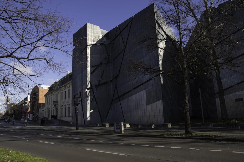 The metallic facade of Berlin's Jeiwsh Museum in Lindenstraße. On the left you can spot the old building that is connected via an underground passage.
