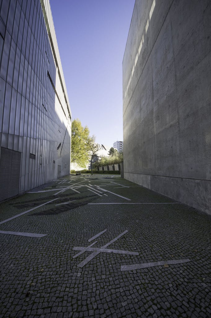 """This courtyrad between the museum and the 'Tower of Holocust' is dedicated to Paul Celan, a lyricist, that is most famous for his """"Todesfuge"""" (death fugue)."""